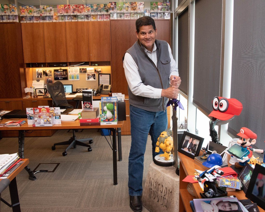 Reggie's collection of Nintendo swag would make any fan envious (Image: Twitter)